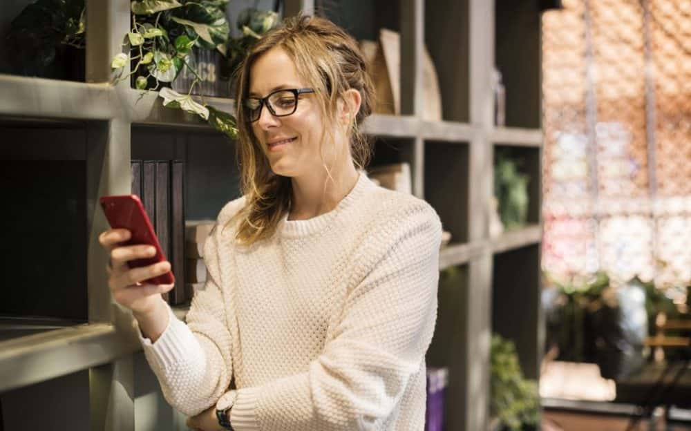 woman smiling with smartphone
